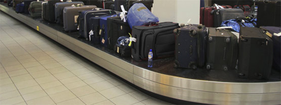 Dark and Grey Suitcases at Baggage Claim